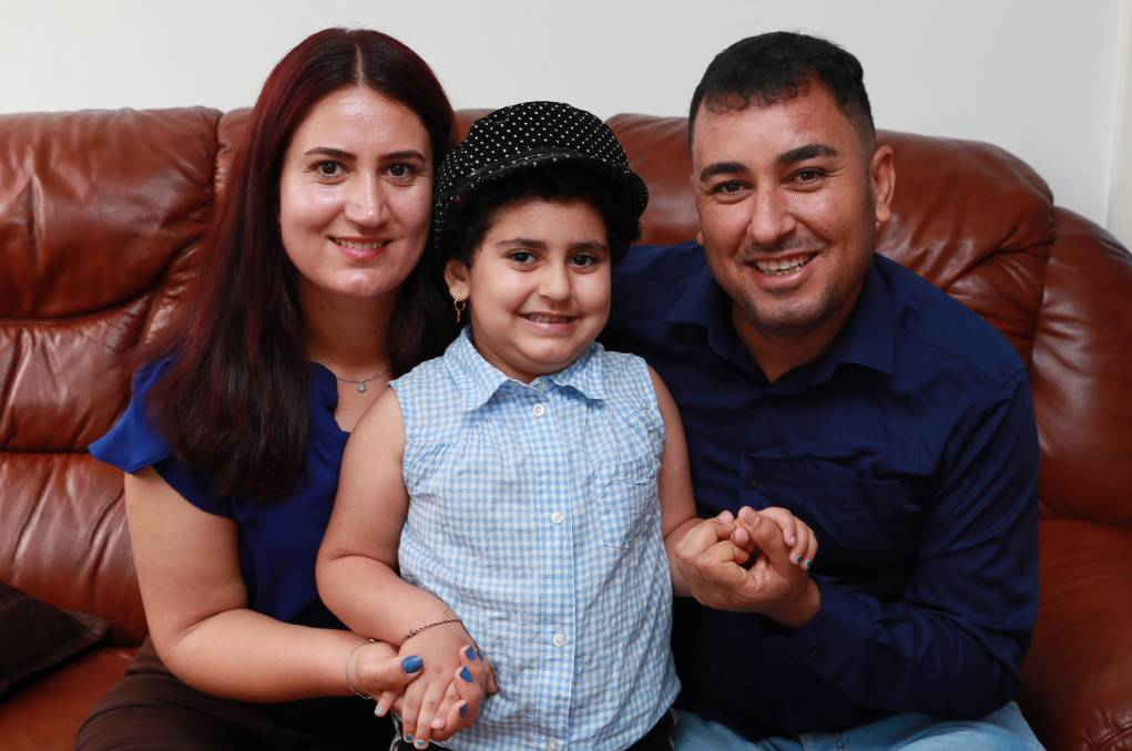 NEW LIFE: Dima Smoki, 5, and her parents Khalaf Smoki and Layla Mahmod, have been in Wagga since 2017. Picture: Les Smith