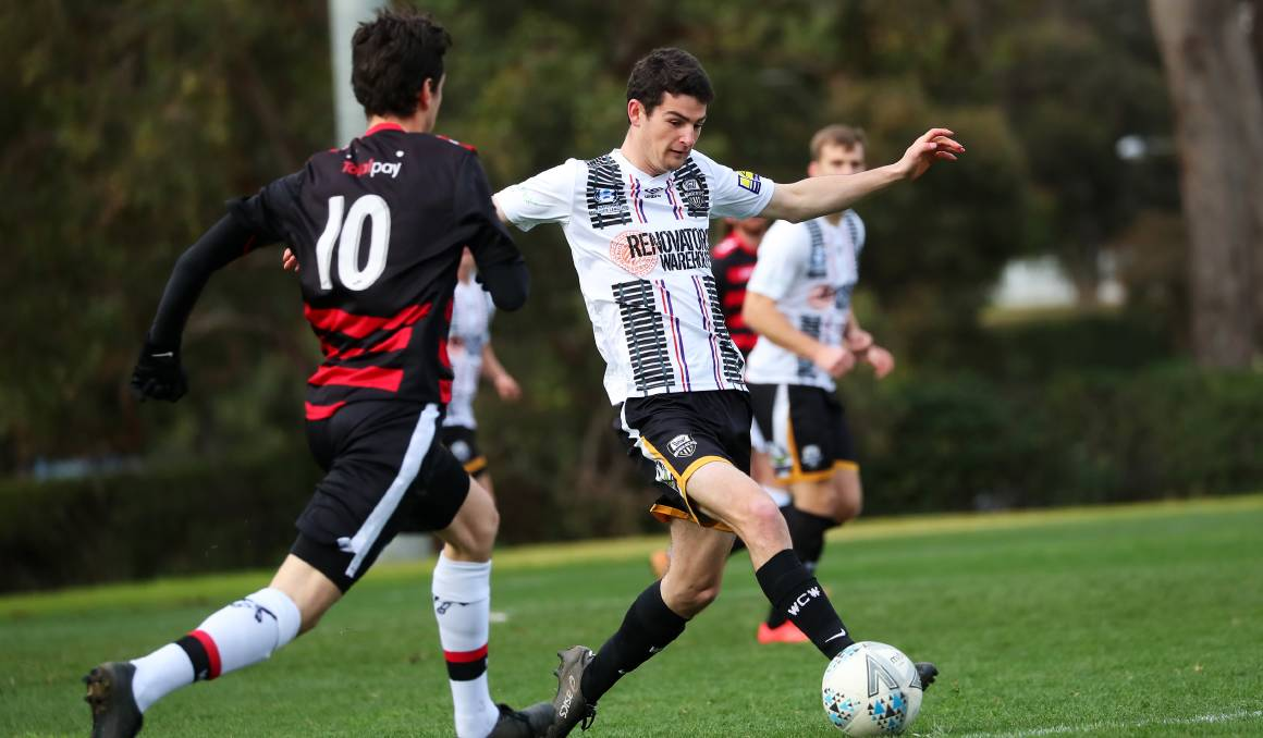 RETURN IMMINENT: William Shuttleworth in action for Wagga City Wanderers against Weston Molonglo last season.