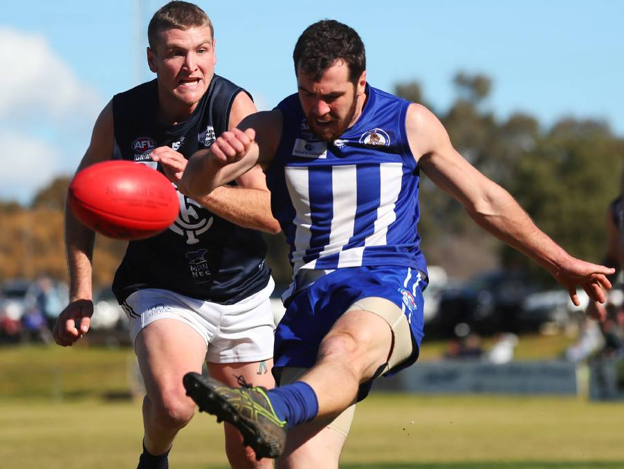 SWITCHING CAMPS: Kieran Shea gets boot to ball in the Farrer League elimination final against Coleambally at Maher Oval in August. Picture: Emma Hillier