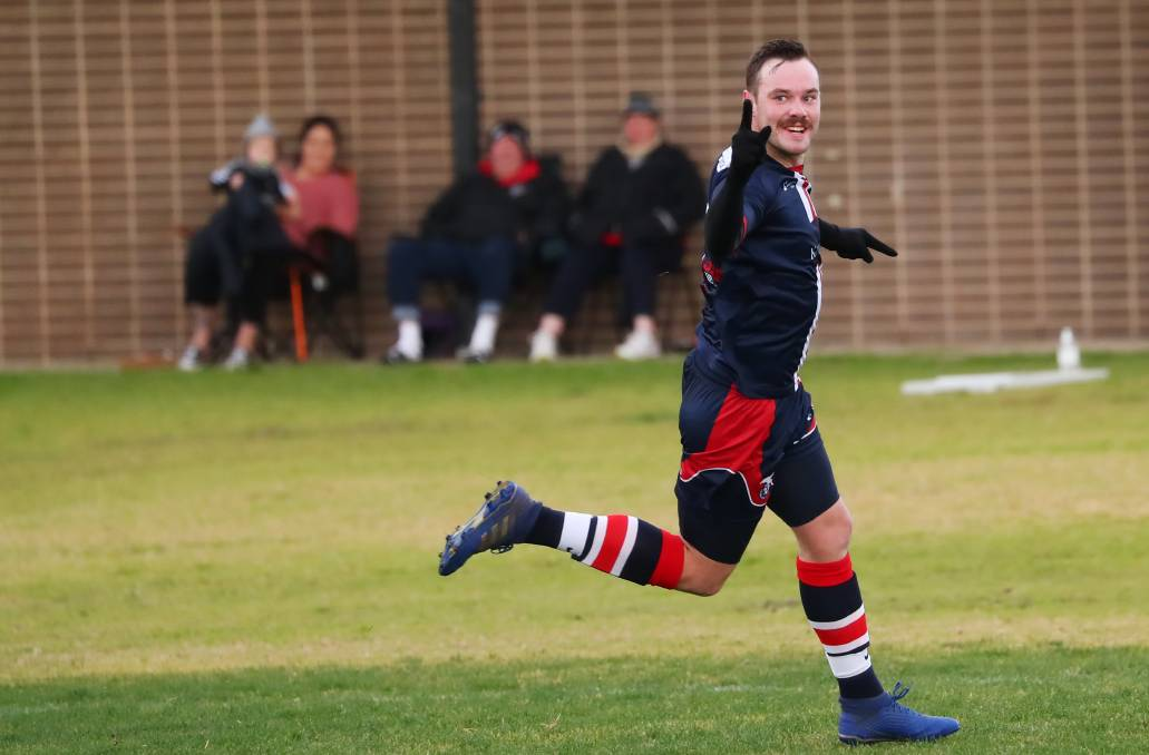 HAPPY DAYS: Henwood Park's Jake Ploenges celebrates one of his two goals against Hanwood at Rawlings Park on Sunday. Picture: Emma Hillier