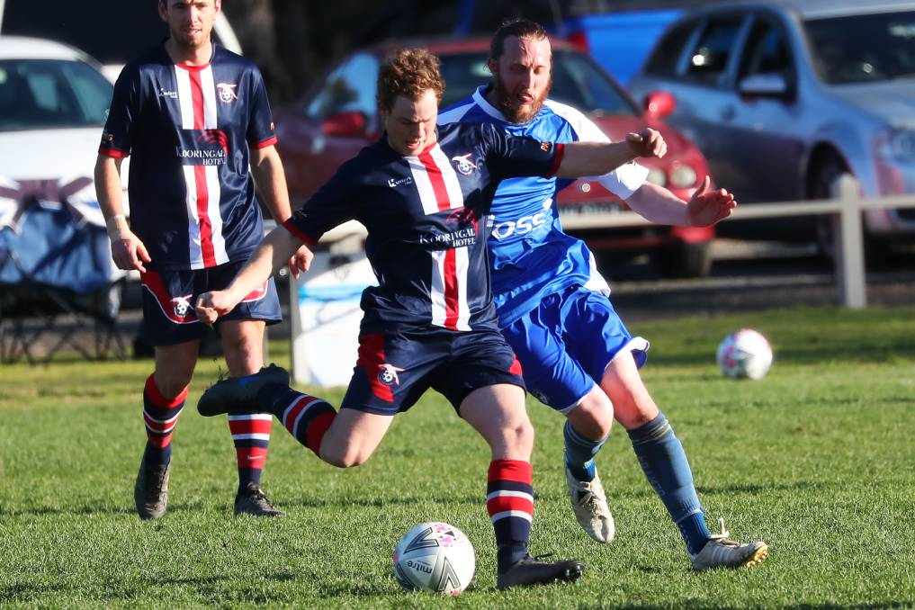 ON TOP: Henwood Park's Joel Tancredi looks to get the ball away despite pressure from Tolland's Julian Boissery at Rawlings Park on Sunday. Picture: Emma Hillier