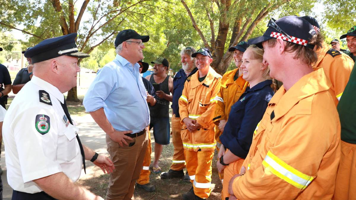 INQUIRY: Prime Minister Scott Morrison and former RFS Commissioner Shane Fitzsimmons meet Tumbarumba's fire volunteers in January. Picture: FILE