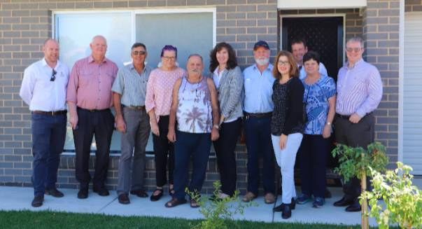 Argyle Housing CEO Wendy Middleton and Temora Council Mayor Rick Firman, along with fellow team members being shown through a newly built Argyle Housing property in Wagga.