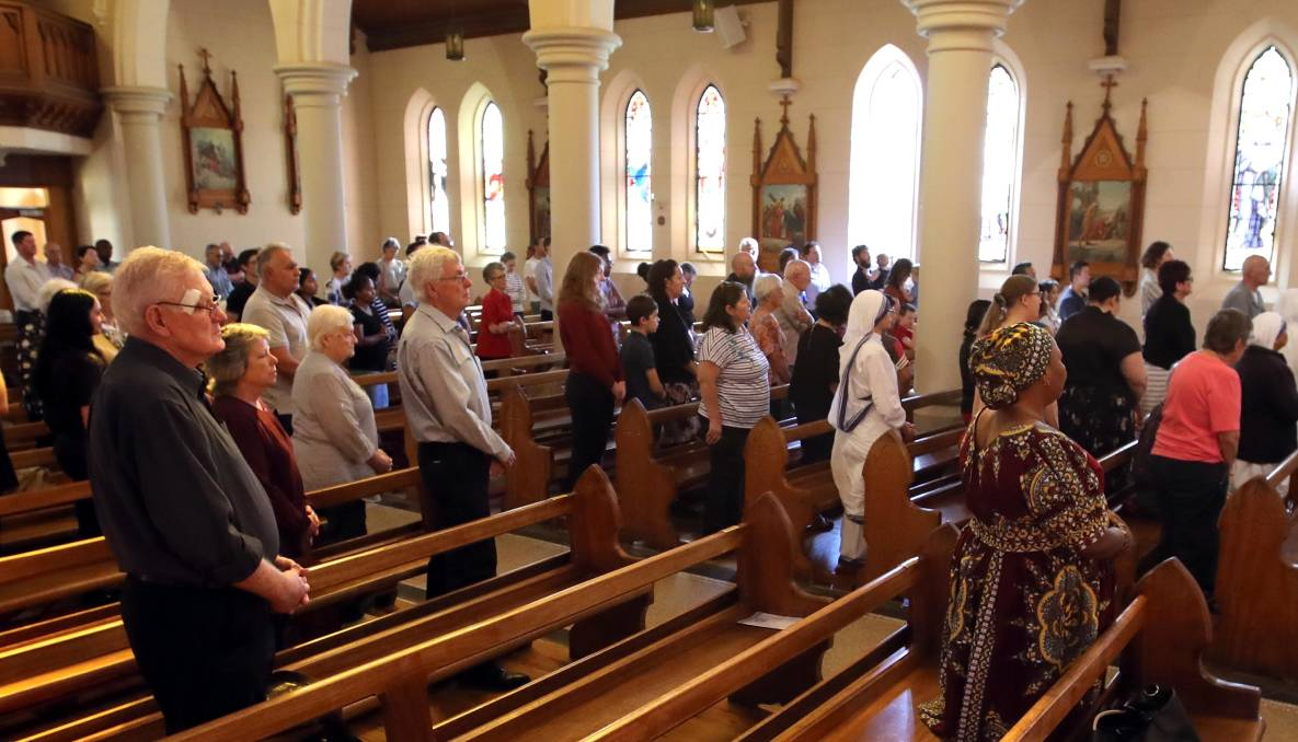 CONGREGATION: Parishioners at a Good Friday Stations of the Cross Mass at St Michael's in 2019.