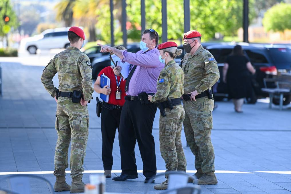CRIME SCENE: Victoria Police and Military Police on Thursday at the scene of shooting at a Wodonga Kmart car park on Wednesday evening. Picture: The Border Mail