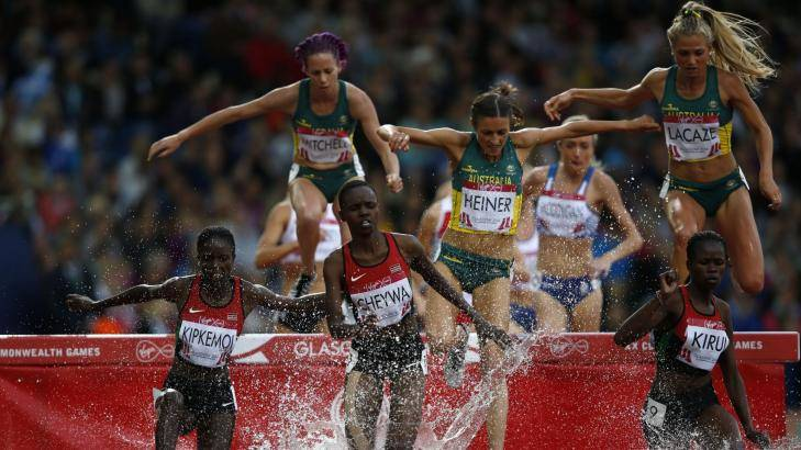 Big jump: LaCaze, at right, in the final of the 3000m steeplechase at the Glasgow Games.  Photo: AFP/Adrian Dennis
