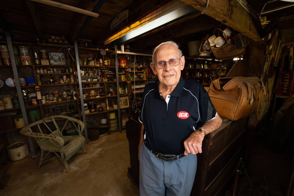 COLLECTOR: Les Dale in the basement of the Henty IGA which featuring a museum of the town. The store celebrates its 60th anniversary on Monday, while Mr Dale has been a business owner for 67 years. Picture: MARK JESSER