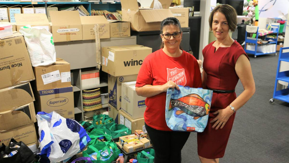 GENEROSITY: Wagga Salvation Army volunteer Kylie Anderson and Ros Robinson are grateful for the many boxes full of food donations. Picture: Jessica McLaughlin
