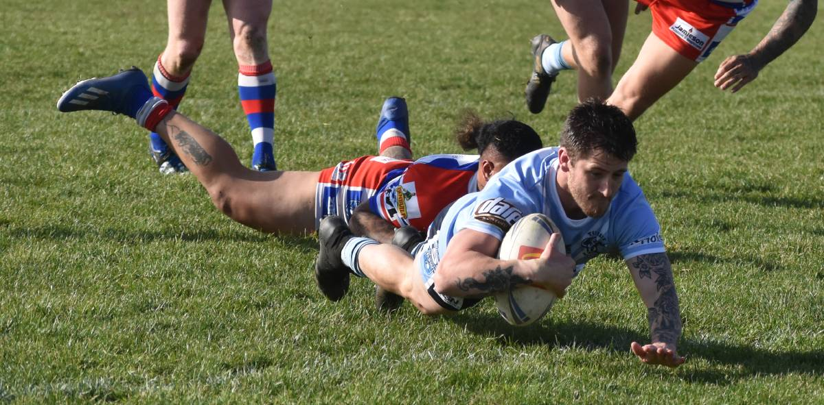 TRY TIME: Lachlan Bristow dives over to score before injuring his ankle in Tumut's win over Young.